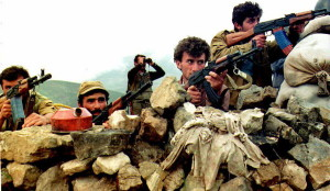 Armenian soldiers fire on Azeri positions near the