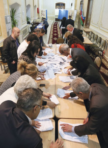 Members of the electoral commission count votes in a poling station in Baku Azerbaijan