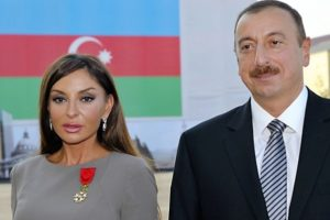 Azerbaijan's President Ilham Aliyev (R) poses beside first lady Mehriban Aliyeva after she was awarded with the Legion d'Honneur medal from the hands of French President Nicolas Sarkozy in Baku in Baku on October 7, 2011. AFP PHOTO / POOL / PHILIPPE WOJAZER (Photo credit should read PHILIPPE WOJAZER/AFP/Getty Images)